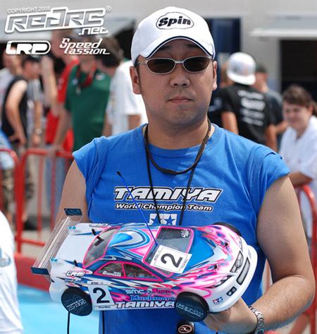 Kiyo Suzuki with Rheinard's car